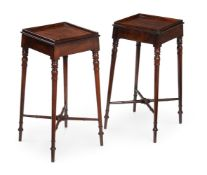 A PAIR OF GEORGE III MAHOGANY URN STANDS, CIRCA 1810