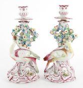 A pair of continental candlesticks in 18th century English style
