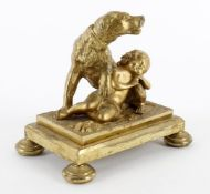 A gilt metal group of a dog protecting a sleeping child