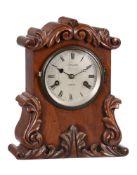 A Victorian carved mahogany small mantel clock