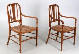 A pair of late 19th century satinwood and marquetry inlaid bedroom armchairs