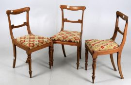 A set of three early Victorian mahogany chairs with needlework seats