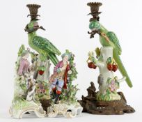 A pair of Continental gilt metal mounted pottery parrot candlesticks