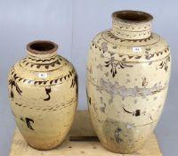 Two large glazed storage vessels