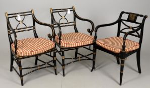 A pair of Regency and later ebonised and parcel gilt simulated bamboo armchairs