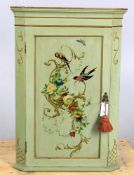 A pale green gilt and polychrome decorated hanging corner cupboard