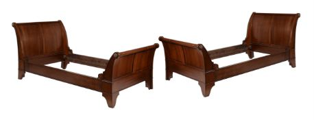 A pair of twin size sleigh beds