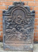 A cast iron fireback depicting Neptune commanding the waves
