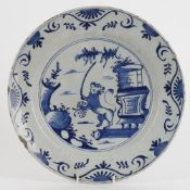 A Dutch Delft blue decorated plate of lion rampant in a landscape