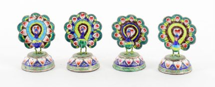 Four Indian white metal and enamelled Peacock menu holders
