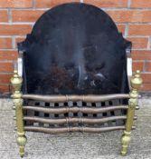 An iron and brass fire grate