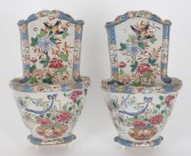 A pair of 19th century French faience wall pockets