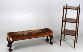 A needlework upholstered foot stool
