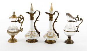 A pair of French opaque white and gilt-metal-mounted scent bottles and stoppers
