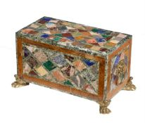 A marble and hardstone casket with bronze handles and feet
