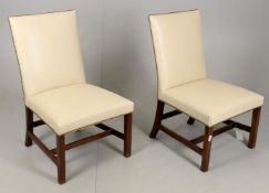 A pair of leather upholstered George III side chairs