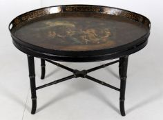 An early 19th century painted twin handled tole ware tray