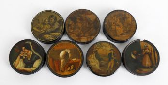 Seven 19th century papier-mâché circular snuff boxes with transfer print decorated tops
