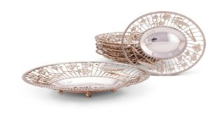 A suite of seven Victorian silver oval bread or grape baskets by Martin, Hall & Co.