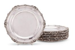A matched set of twelve Victorian silver shaped circular dinner plates