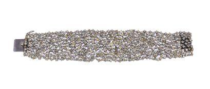A brown and yellow diamond bracelet
