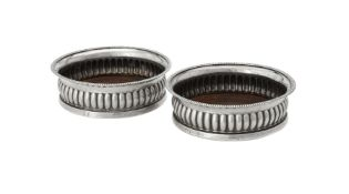 A pair of George III silver mounted wine coasters by John Roberts & Co.