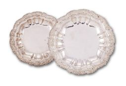 A pair of late George III silver shaped circular course dishes by Joseph Angell I