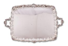 An Edwardian silver shaped rectangular twin handled tray by Wakely & Wheeler (James Wakely & Frank C