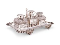A late Victorian silver shaped Victorian two bottle inkstand by D. & J. Wellby
