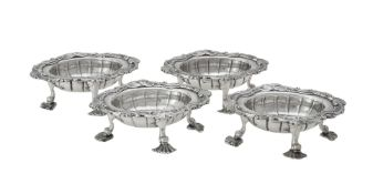 A set of four George II silver shaped oval salts by David Hennell I