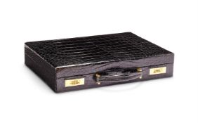 Y Chaumet, a crocodile and 18 carat gold mounted briefcase