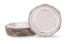 A set of twelve silver shaped circular side plates by Sydney Bellamy Harman