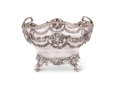 An Edwardian silver mounted cut glass quatrelobed bowl by William Comyns & Sons