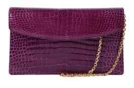 Y William & Son, a purple crocodile clutch bag