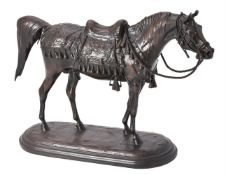 A patinated bronze model of an Arab stallion
