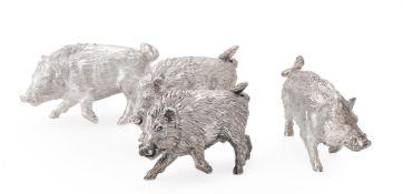 Three silver models of wild boar running by William & Son (William Rolls Asprey)