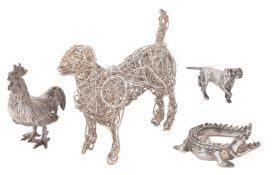 Y Four silver models of animals