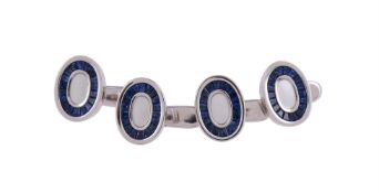 Y Four mother of pearl and sapphire dress studs by William & Son