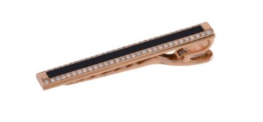 An onyx and diamond tie clip by William & Son