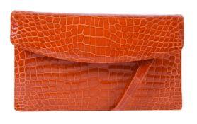 Y William & Son, an orange crocodile clutch bag
