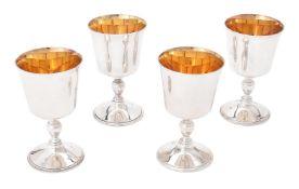 A set of four silver goblets by William & Son (William Rolls Asprey)