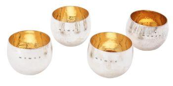 A matched set of four Britannia standard silver tumbler cups by William & Son (William Rolls Asprey)