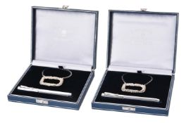 Two silver wine label and rhodium plated Caron d'Ache fountain pen sets