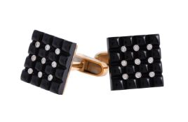 A pair of onyx and diamond cufflinks by William & Son