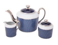 A modern Limoges Pied de Poule pattern tea pot by Legle