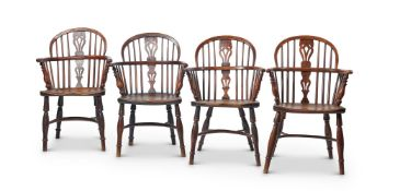 A HARLEQUIN SET OF EIGHT YEW AND ELM LOW BACK WINDSOR CHAIRS