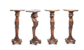 A SET OF FOUR ITALIAN CARVED WALNUT PEDESTALS, 20TH CENTURY