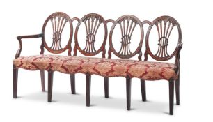 A GEORGE III CARVED PADOUK CHAIR-BACK SETTEE