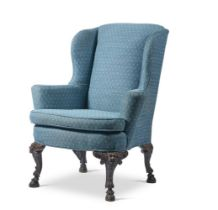 A CARVED WALNUT WING ARMCHAIR, IN IRISH GEORGE II STYLE, LATE 19TH CENTURY