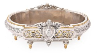 A SILVERED BRONZE AND PARCEL GILT OVAL TABLE CENTREPIECE, 19TH CENTURY